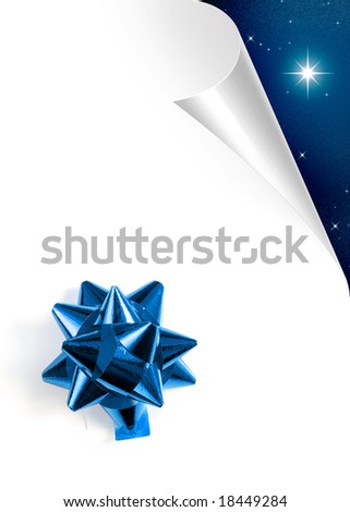 Turning white paper page with blue Christmas bow - stock photo