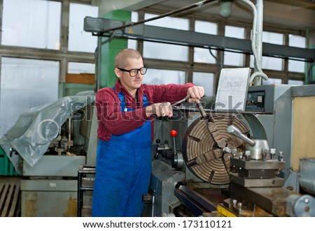 Turning work. A man working on the machine - stock photo