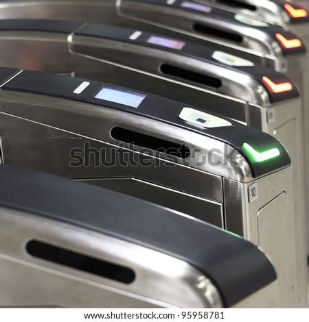 Turnstiles at entrance of modern MRT. - stock photo