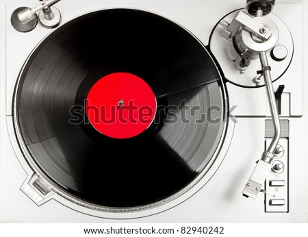 Turntable - dj's vinyl player with a red vinyl disk on it, view from above. - stock photo