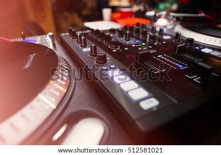 Turntable dj vinyl record player and sound mixing controller.Analog and digital sound technology for DJ to play music.Close up, macro of disc jockey equipment for professional studio,concert,event set