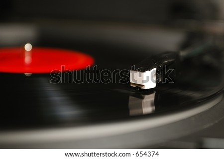 Turntable in motion - stock photo