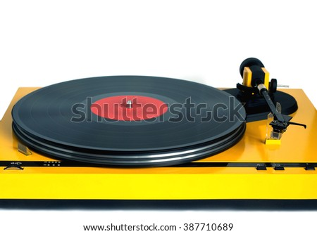 Turntable in yellow case with rotation vinyl record with red label isolated on white background. Horizontal photo front view closeup - stock photo