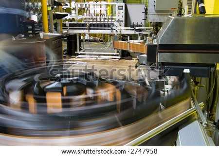 Turntable of bottling line at a lubricant manufacturing facility - stock photo