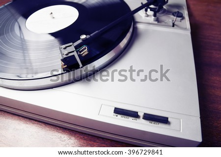 Turntable player with musical vinyl record. Useful for DJ, nightclub and retro theme. Instagram hipster color effect - stock photo