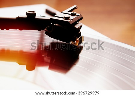 Turntable player with musical vinyl record. Useful for DJ, nightclub and retro theme. Instagram hipster film filter effect - stock photo