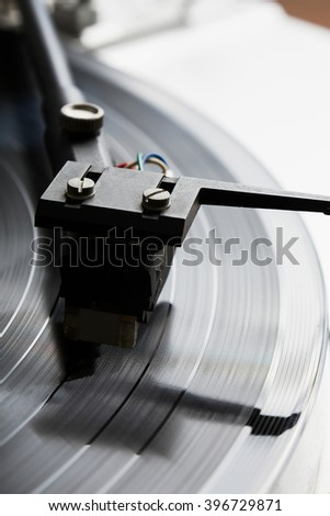 Turntable player with musical vinyl record. Useful for DJ, nightclub and retro theme. Time code in focus - stock photo