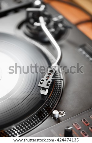 Turntable vinyl record player, analog sound technology for DJ playing analog and digital music. Close up, macro of equipment for professional studio, concert, event.  - stock photo