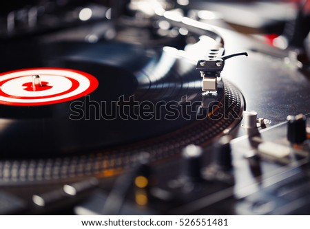 Turntable vinyl record player,analog sound technology for dj playing analog and digital music.Equipment for professional studio,concert,event.Disc jockey mix music tracks here.DJ play music records