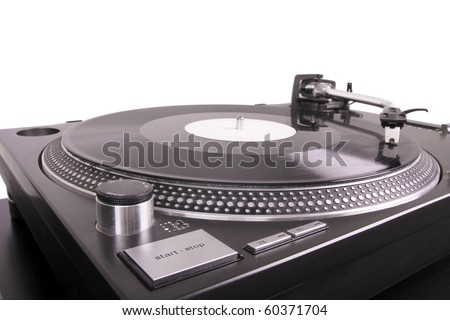 Turntable with dj needle on record, closed-up on black table - stock photo