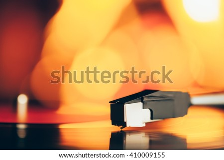 turntable with LP vinyl record against burning fire background - stock photo
