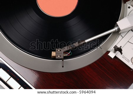 Turntable with phonograph record - stock photo