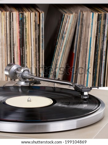 Turntable with record collection in the back - stock photo