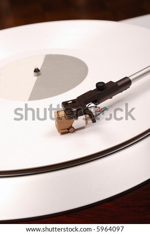 Turntable with white phonograph record - stock photo