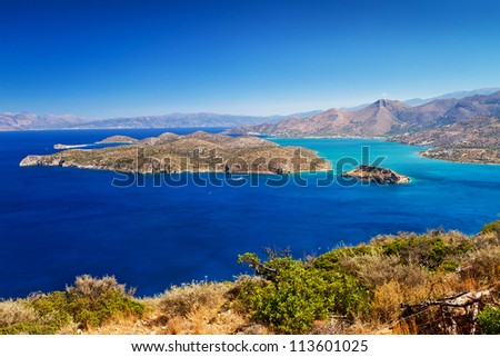 Turquise water of Mirabello bay with Spinalonga island on Crete, Greece