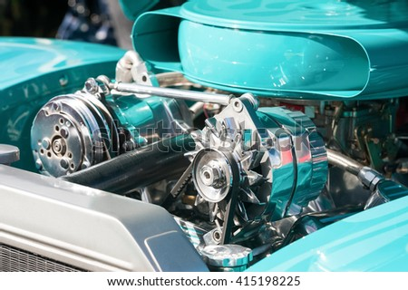 turquoise and chrome engine bay on a high performance vehicle - stock photo