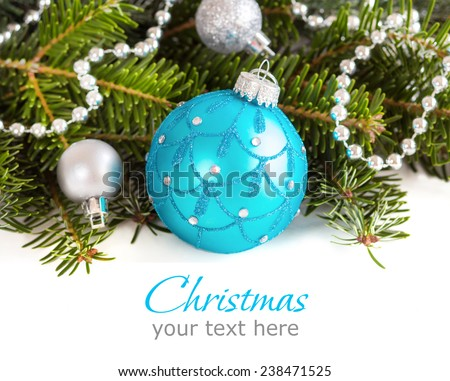 Turquoise and silver Christmas ornaments border on white background