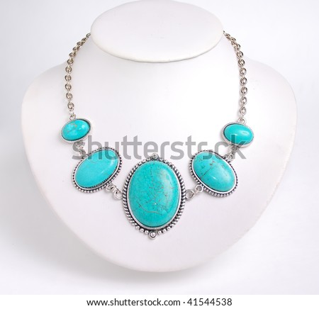 Turquoise black necklace on white background - stock photo