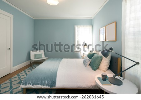 Turquoise Blue bedroom with matching decoration  - stock photo