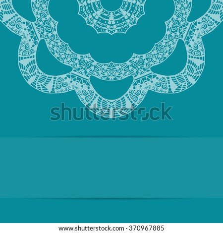 Turquoise blue card with decorative round ornate pattern zentangle style and copy space below - stock photo