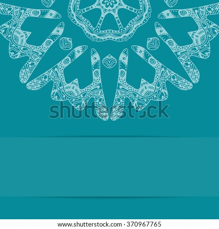 Turquoise blue card with zentangle style ornate pattern  and copy space below - stock photo