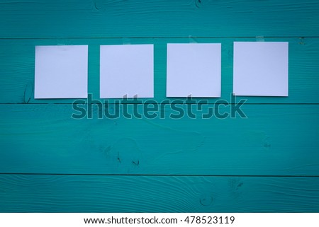 Turquoise boards with paper cards background concept