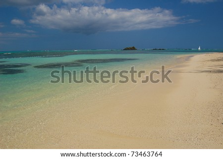 Turquoise calm water on tropical Mont Choisy beach on Mauritius Island - stock photo