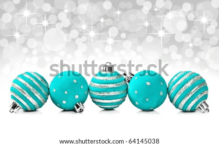 Turquoise christmas decoration balls on a star background with space for text