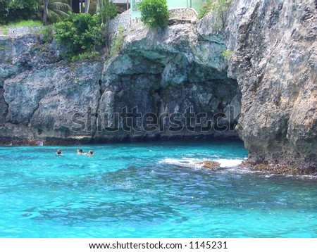 TURQUOISE COAST. Cave on Negril coast, Jamaica. No color enhancement, the sea was that color. - stock photo