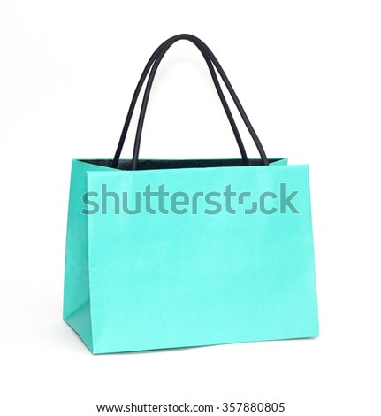 Turquoise color paper bag on white background.