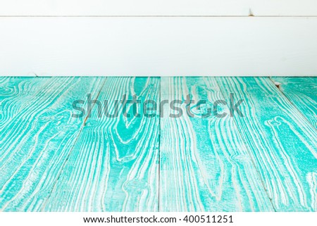 turquoise colored wooden table and white painted wooden background