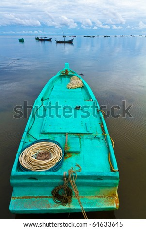 Turquoise fisher boat in Ham Ninh, Phu Quoc, Vietnam - stock photo