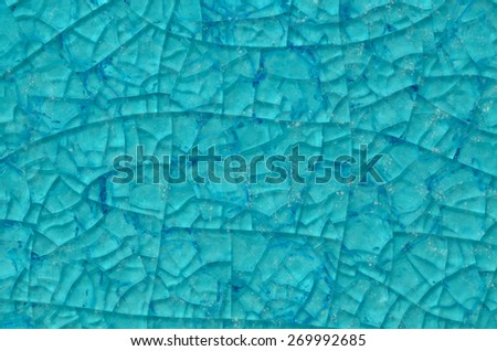 turquoise glass tile cracked texture - stock photo