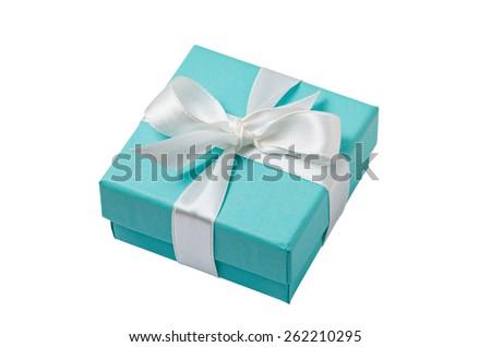 Turquoise isolated gift box with white ribbon on white background - stock photo