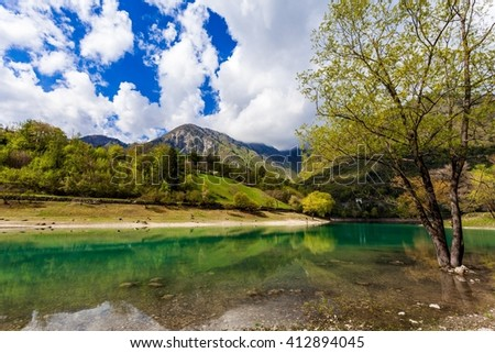Turquoise lake in the mountains. Lake Tenno. Italy