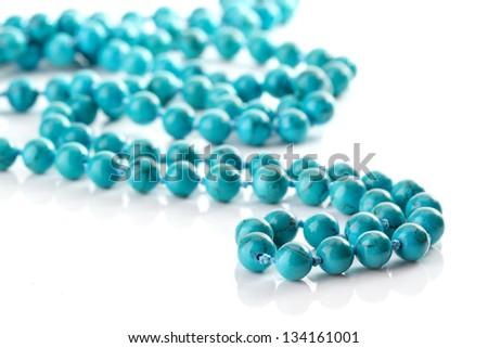 Turquoise necklace and bracelet isolated on white - stock photo