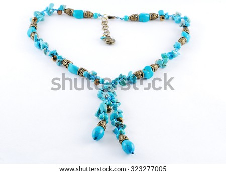 Turquoise necklace on white background