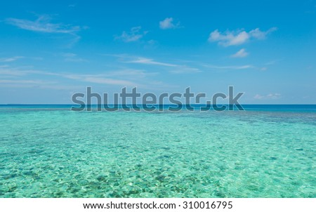 Turquoise ocean under a blue sky. Maldives. - stock photo