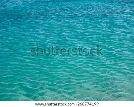Turquoise rippled sea water surface background, texture - stock photo