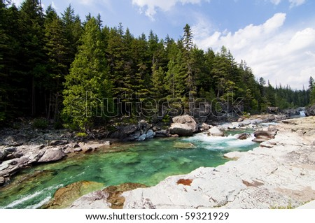Turquoise river flowing towards Lake McDonald at Glacier National Park