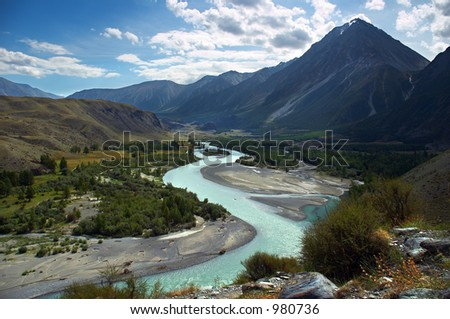 turquoise river, mountains and skies. Altay - stock photo