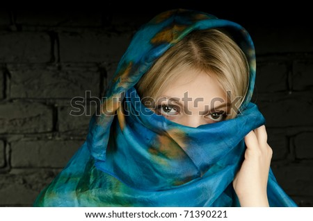 Turquoise scarf cover face of girl