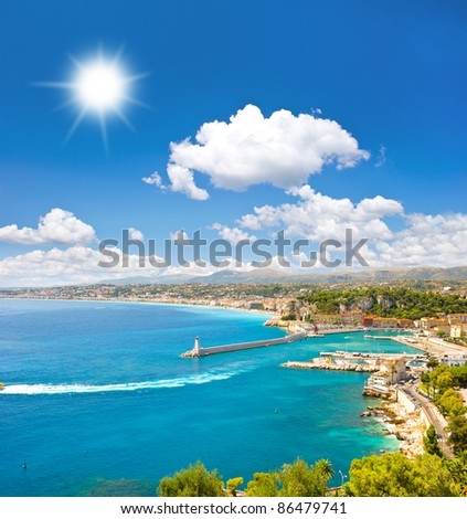 turquoise sea and perfect sunny blue sky. View of mediterranean resort, Nice, Cote d'Azur, France - stock photo