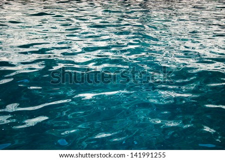 Turquoise sea surface with waves. - stock photo