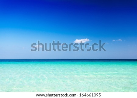Turquoise sea water and blue sky background - stock photo