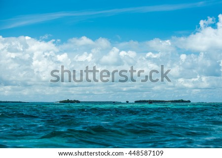 Turquoise sea water and blue sky with white clouds, Indian Ocean