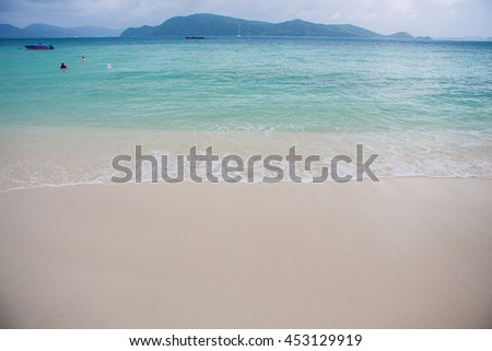 Turquoise sea wave foam on Karon beach, Phuket, Thailand. Exotic summer paradise, Asia. Beautiful water nature. Perfect summer resort for relax. Colorful sea. Sea waves near beach. Beautiful sea beach