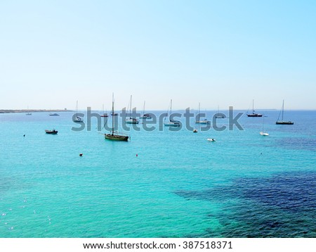 Turquoise sea with boats anchored