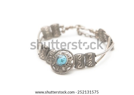Turquoise stone in a silver bracelet  - stock photo