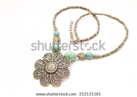 Turquoise stone in a silver Necklace - stock photo